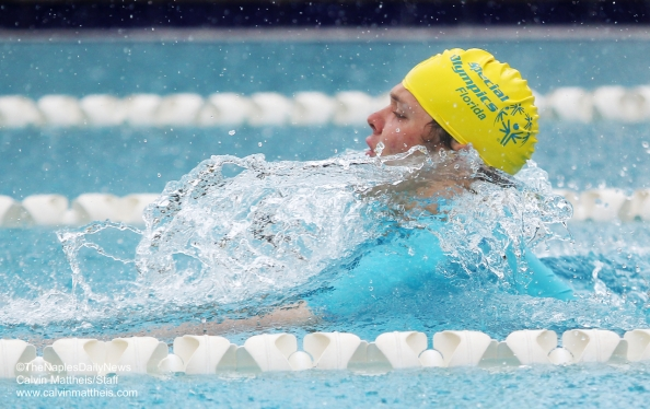 Peter Burns swims the breast stroke at the Special Olympics of Florida Aquatics Competition at River Park Aquatic Facility in Naples, Florida, on Thursday, July 23, 2015. About 35 competitors, ranging from age 10 to 30's, participated in swimming events.(Calvin Mattheis/Staff)